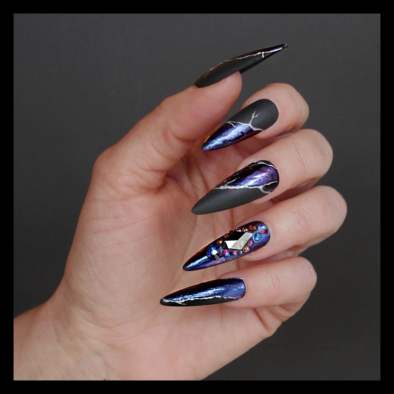 Stiletto nails with lightning and iridescent design