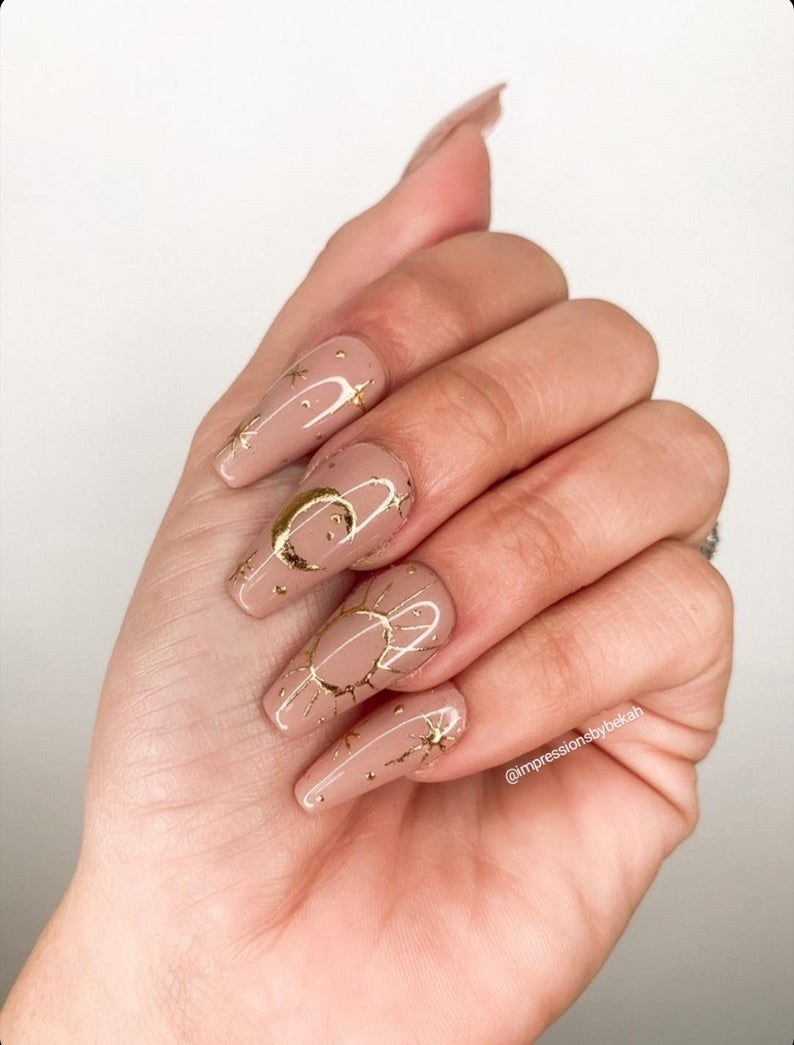 Nude nails with gold decals