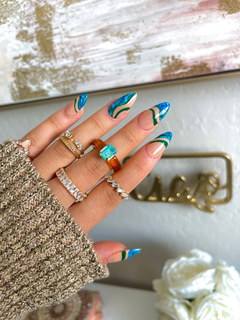 Wavy abstract blue nails with swirls