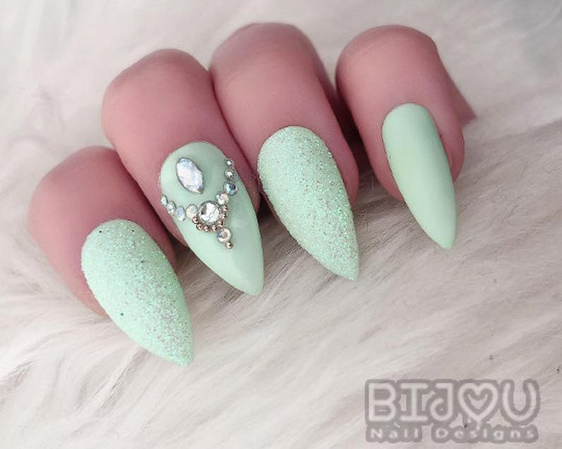 Mint green nails with rhinestones