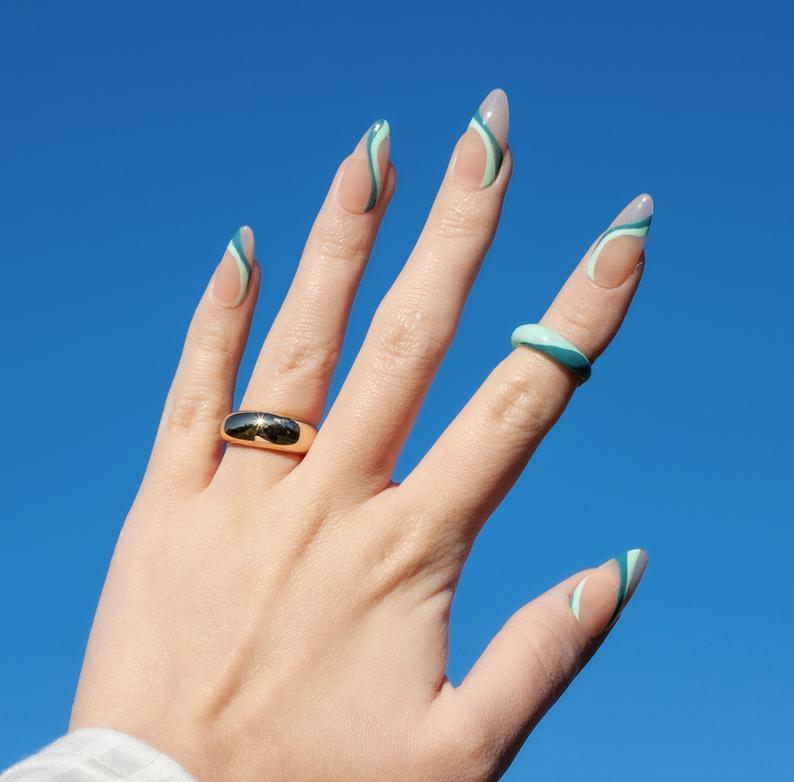 Wavy blue almond nails