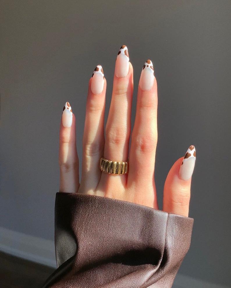 Cow print almond nails