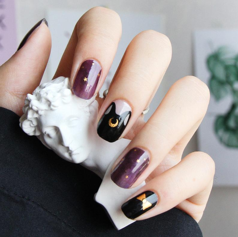 Purple and black gel nails with crescent moon and stars