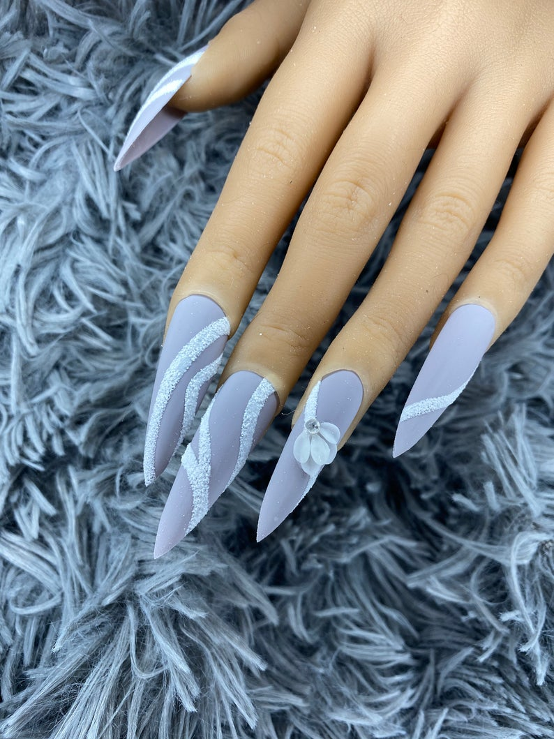 Powder blue stiletto nails with white accents
