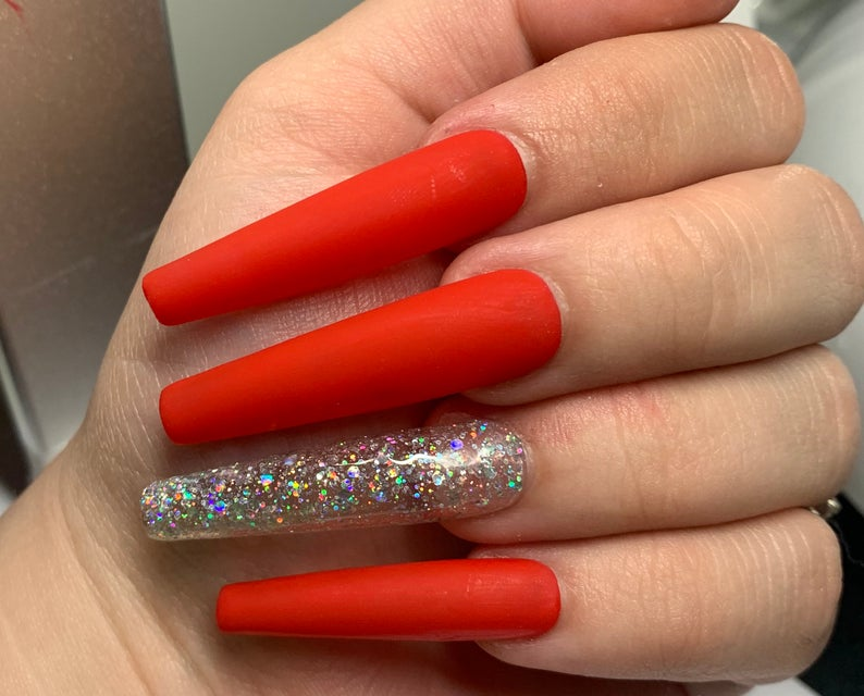 Red nails with transparent glitter