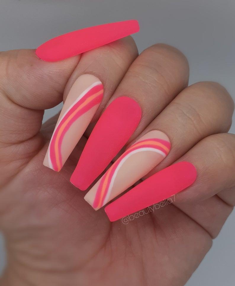 Pink matte nails with swirls