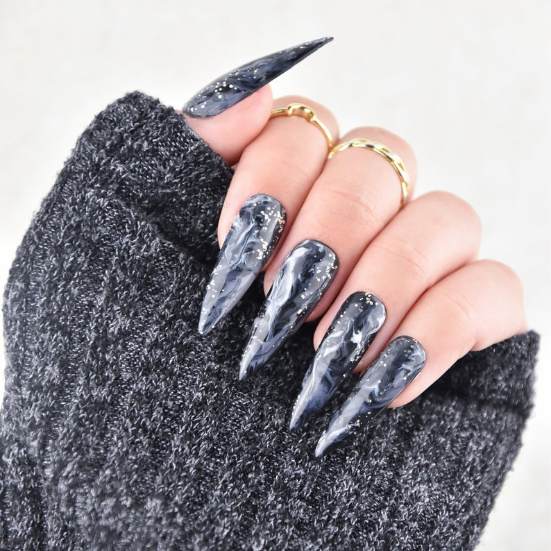 Grey stiletto nails with white swirls