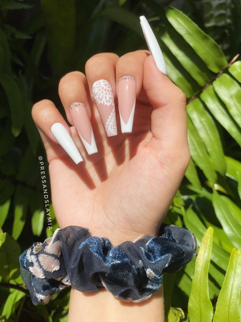 Nude nails with white lace