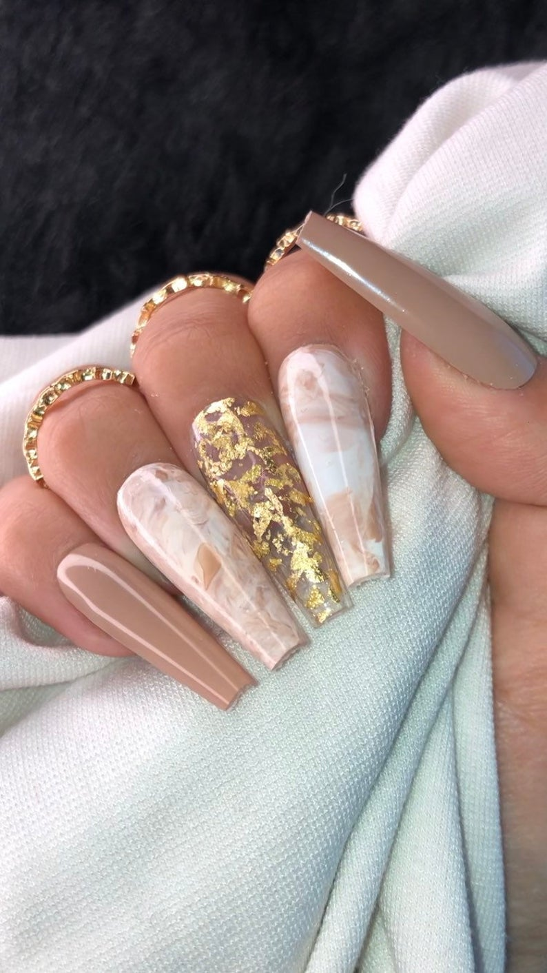 Nude and marble nails with gold flakes