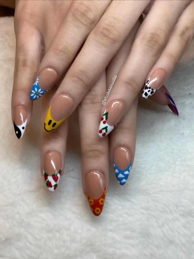 Almond nails with cute patterns on tips