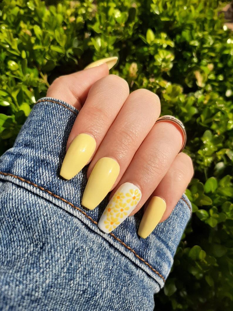 Soft pastel yellow nails