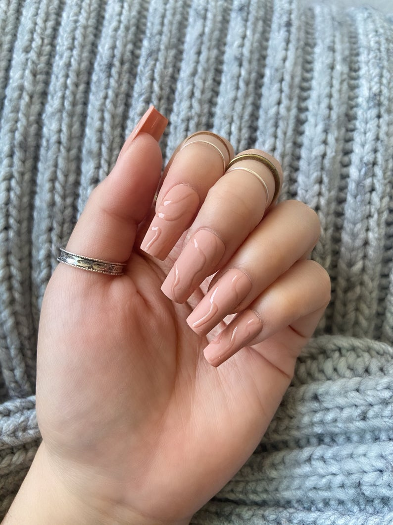 Nude nail design with swirls