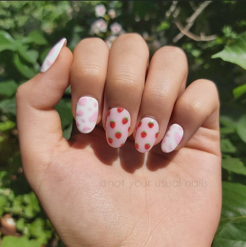 Strawberry and cow print nail art