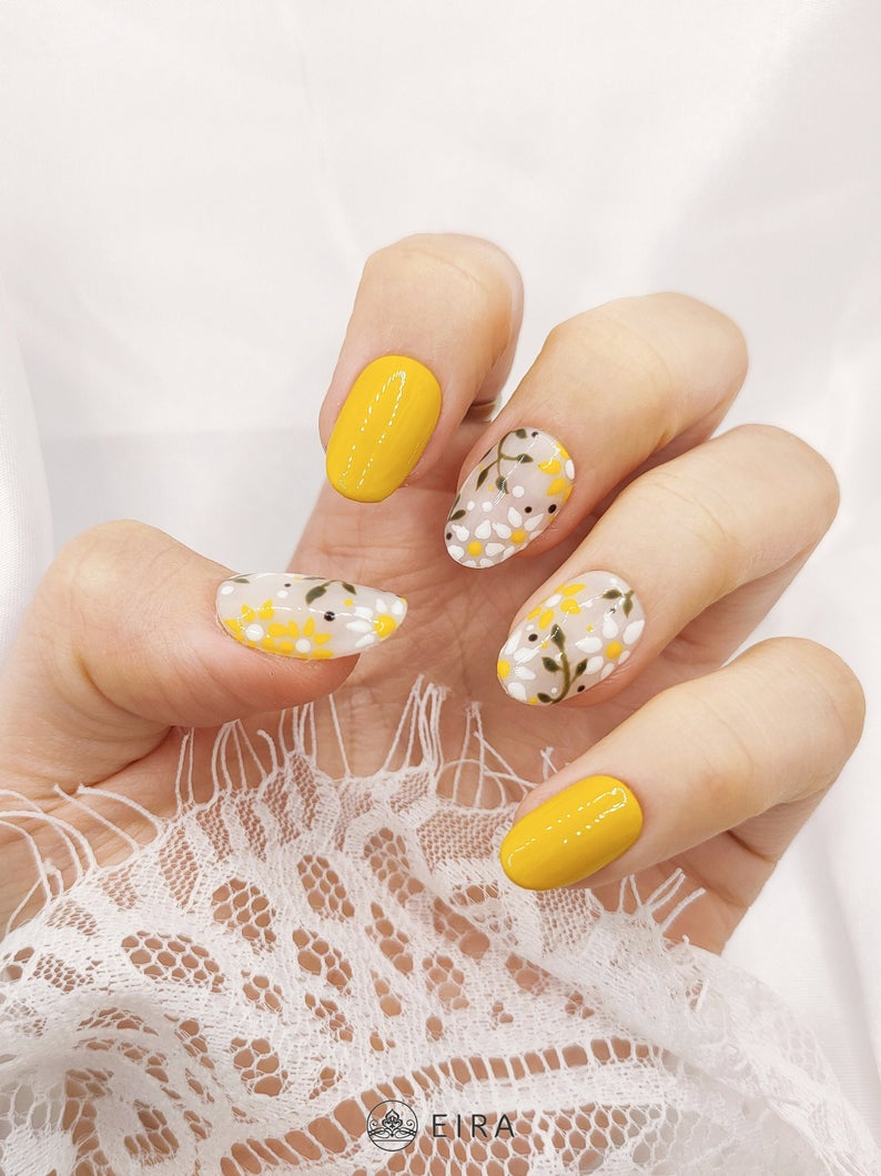 Mustard yellow nail art with floral pattern