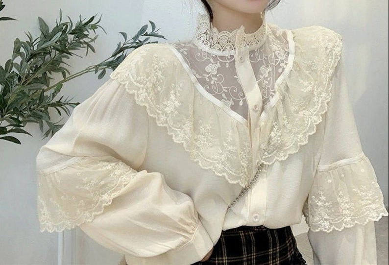 Vintage-type white blouse with ruffles for dark academia outfits