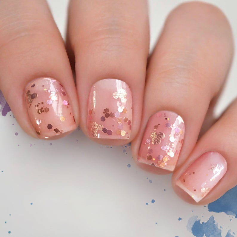 Transparent nails with gold glitter