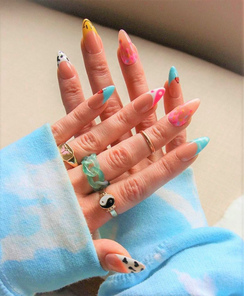 Almond nail design with different artworks