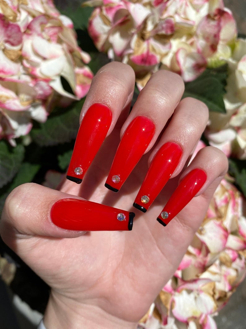 Red nails with black tips