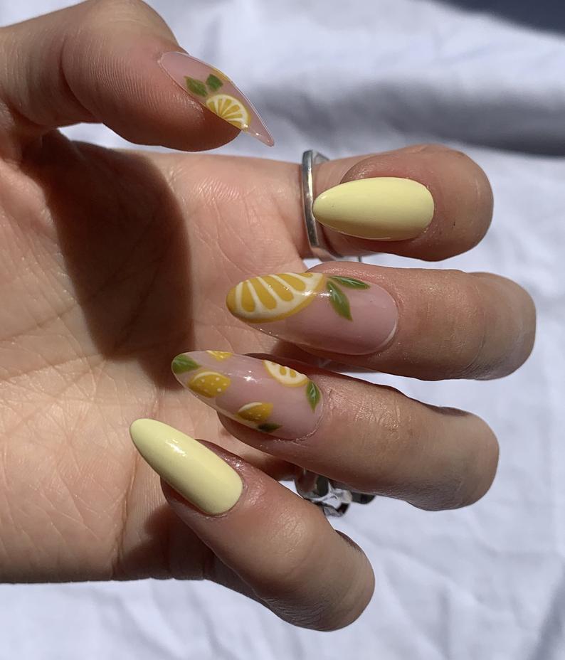 Almond nails with lemon design