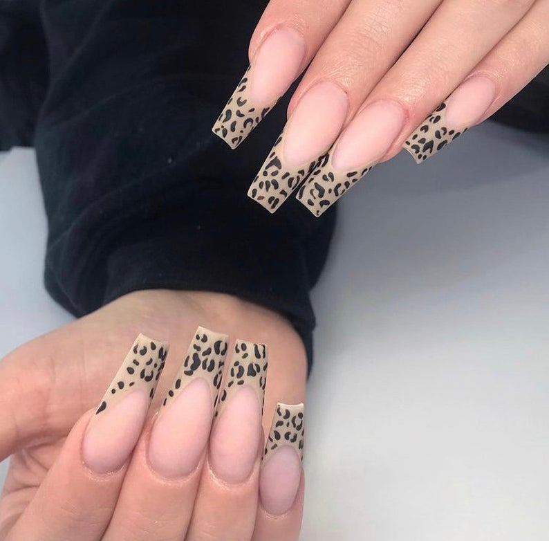 Clear nails with leopard tips