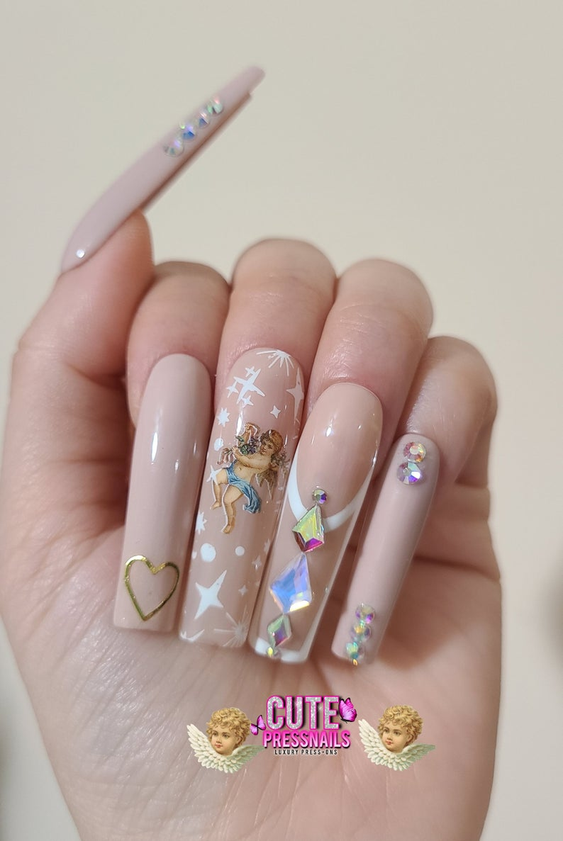 Nude nails with rhinestones and angels