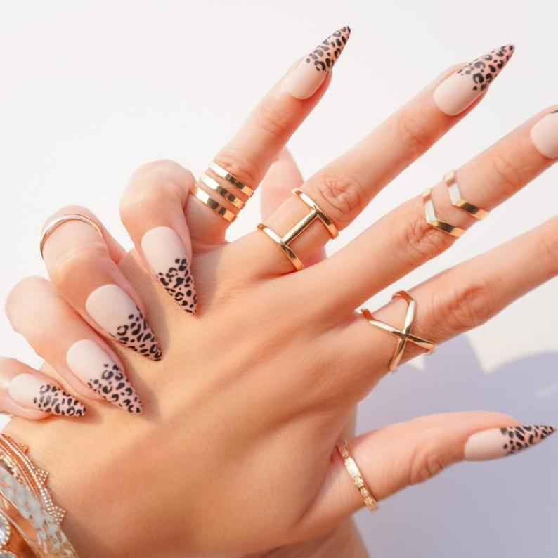 Nude nails with leopard prints design