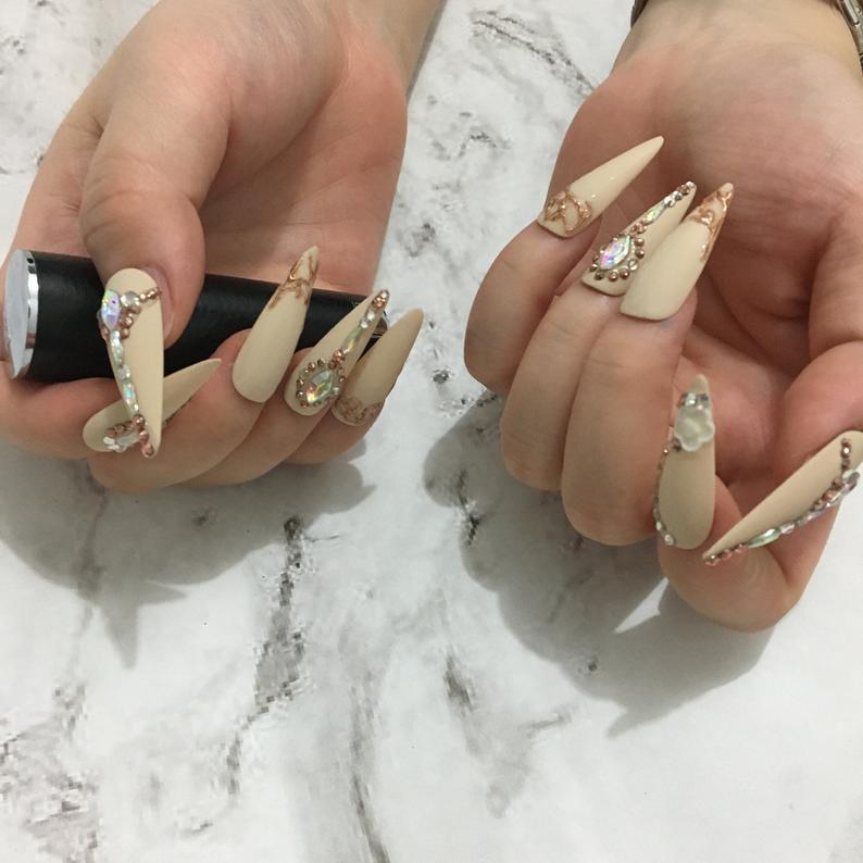 Matte cream stiletto nails with rhinestones