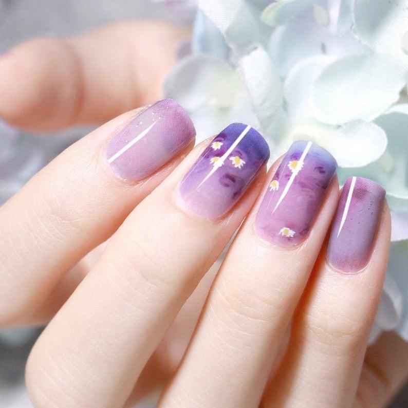 Dainty purple floral gel nails