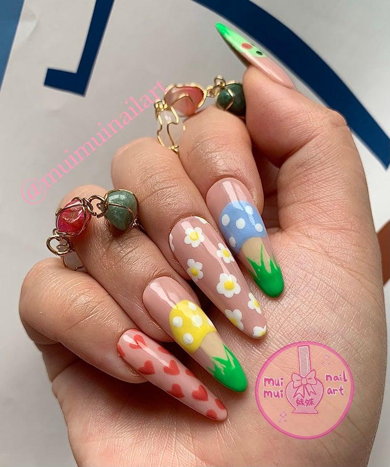 Mushroom and daisies nail art