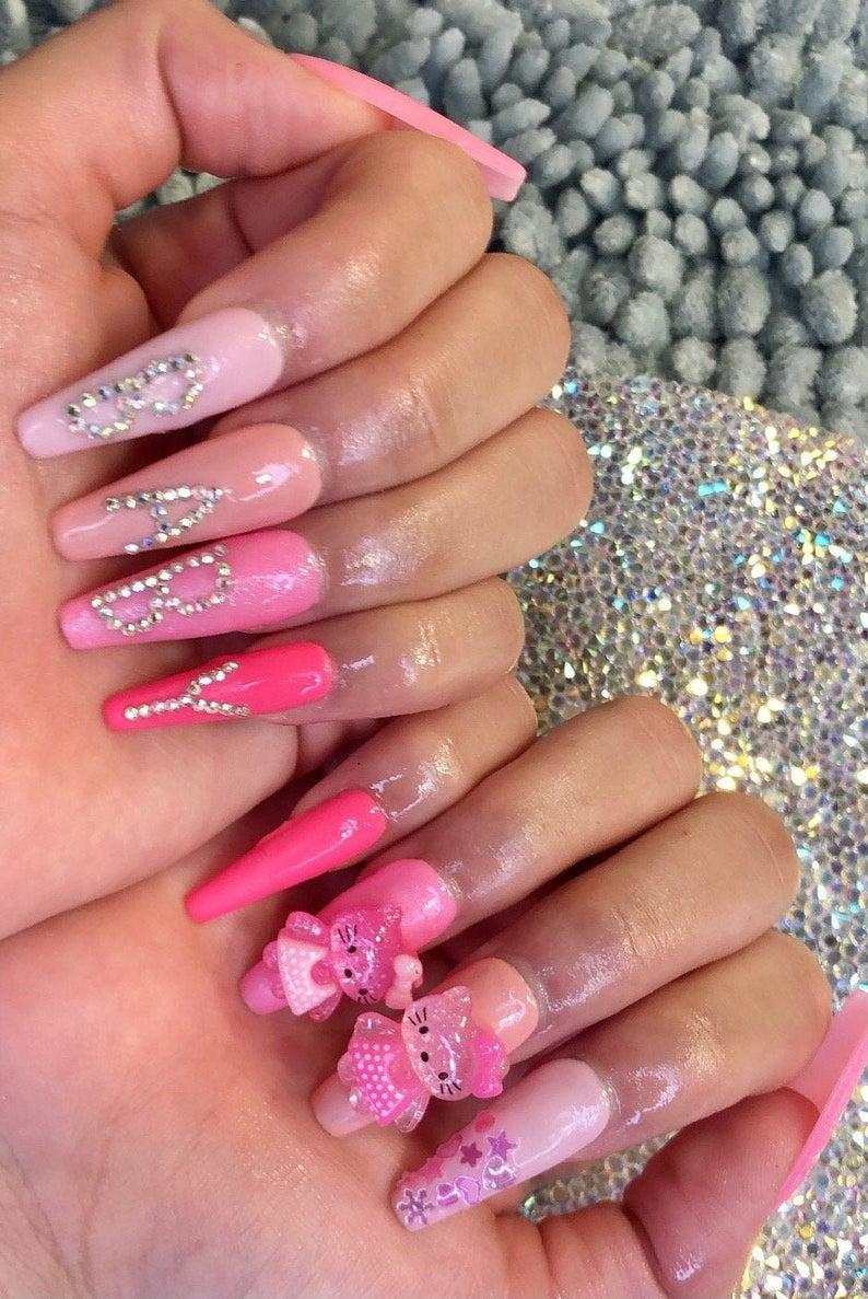Hot pink kawaii Hello Kitty nails