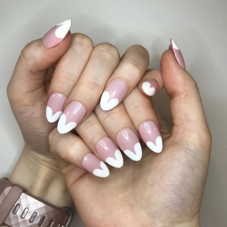 Almond nails with heart tip