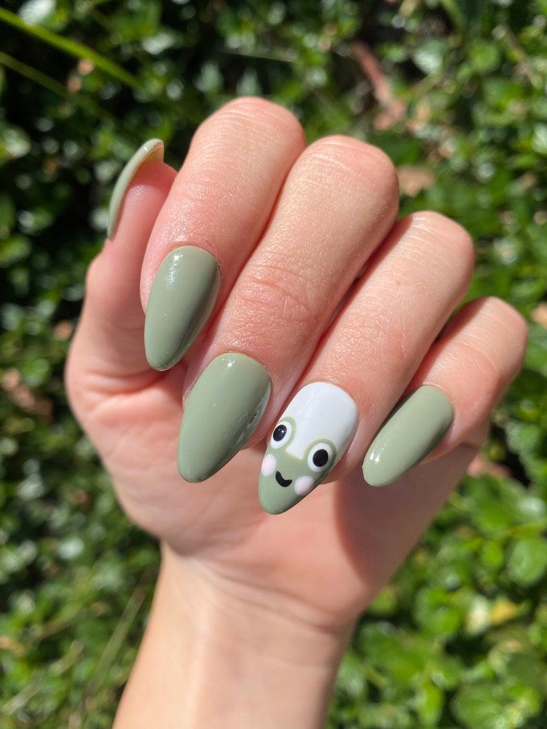 Sage green frog nail art