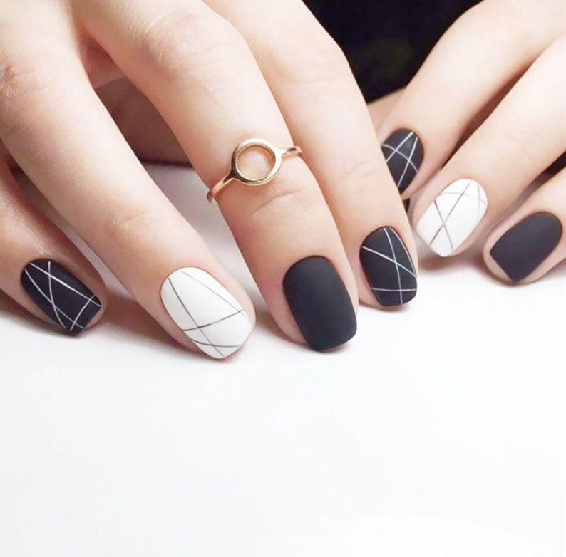 Matte abstract black and white nails