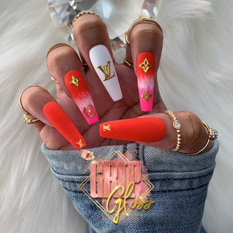 Orange LV design for coffin nails