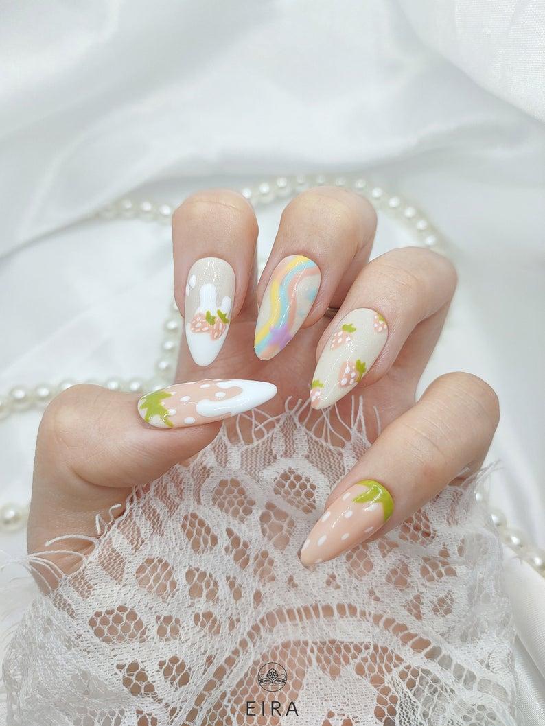 Soft pink strawberry nail art