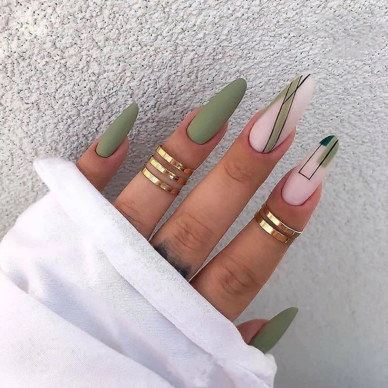 Olive green nails wirth abstract designs