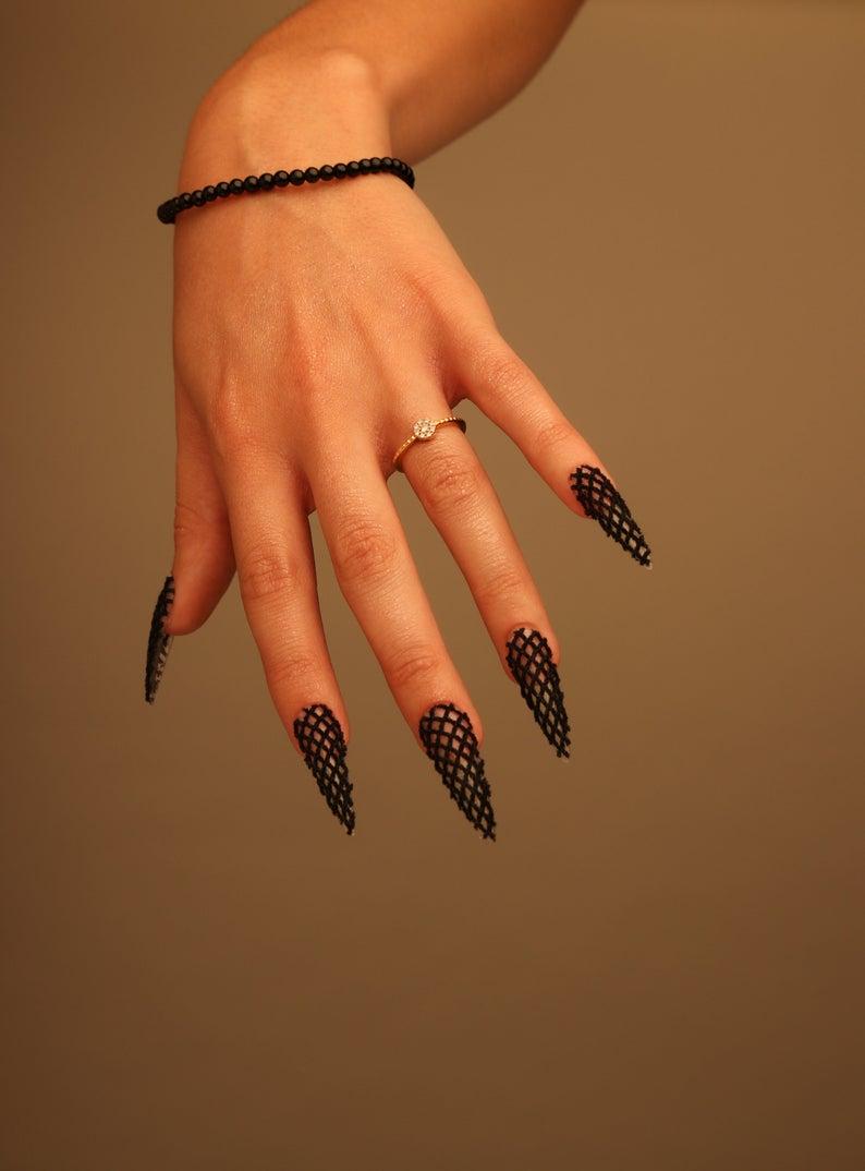 Stiletto nail design with black fishnets
