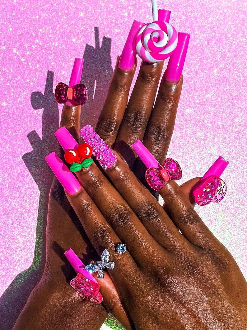 Kawaii hot pink nails with ribbons and cherries