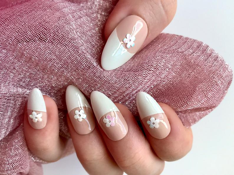 Almond nails with white tips and flowers
