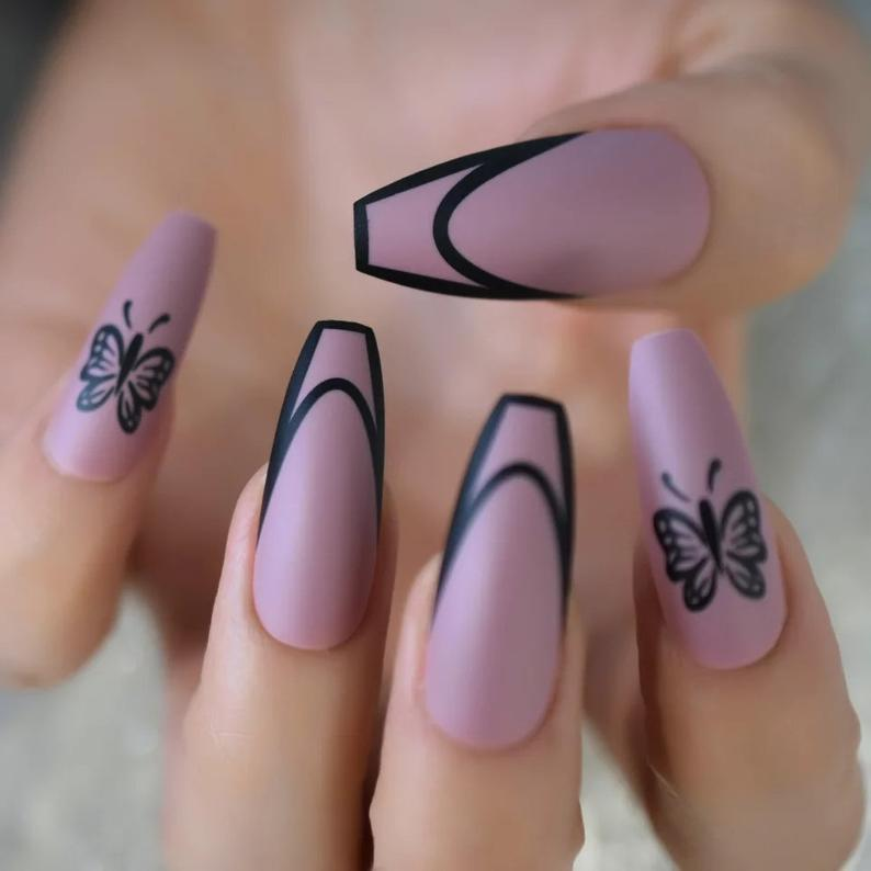 Soft purple matte nails with butterflies and black accents