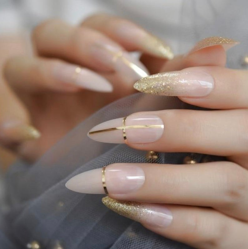 Nude nails with dainty gold accents