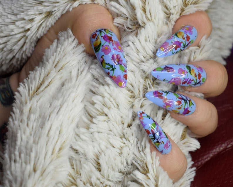 Light blue stiletto nails with flowers