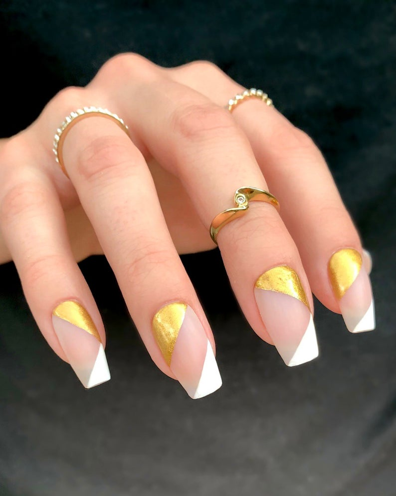 Asymmetrical white and gold nails