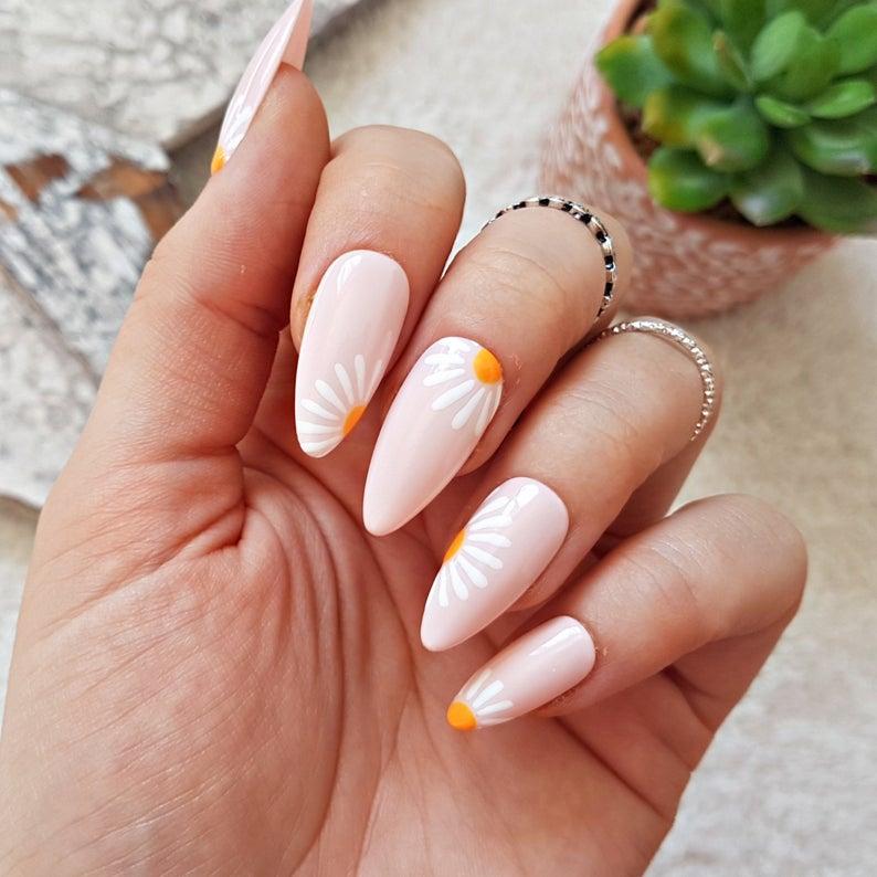 Pastel pink with daisies nail art