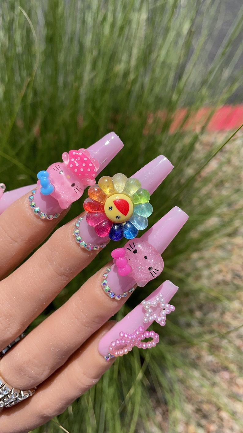 Cute nail design with embellishments for coffin nails