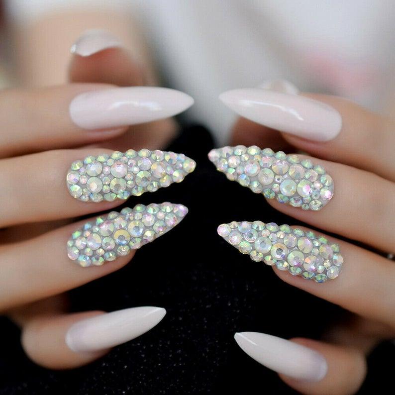 Light pink stiletto nails with rhinestones