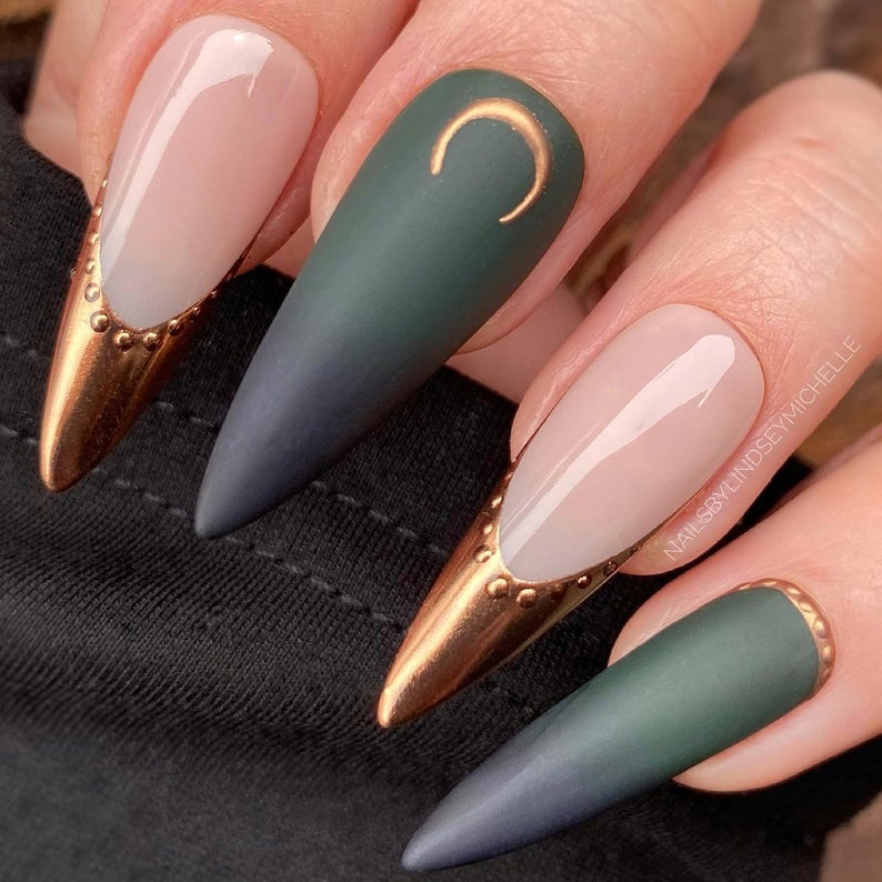 Pink and olive green stiletto nails with crescent moon and gold accents