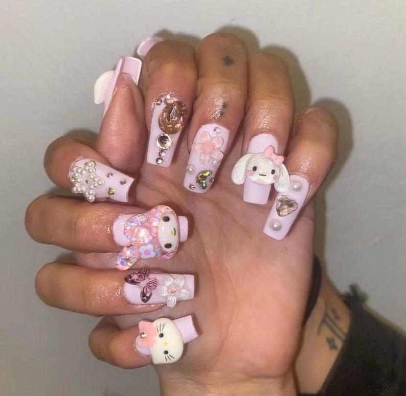 Pink kawaii nail art with Hello Kitty characters