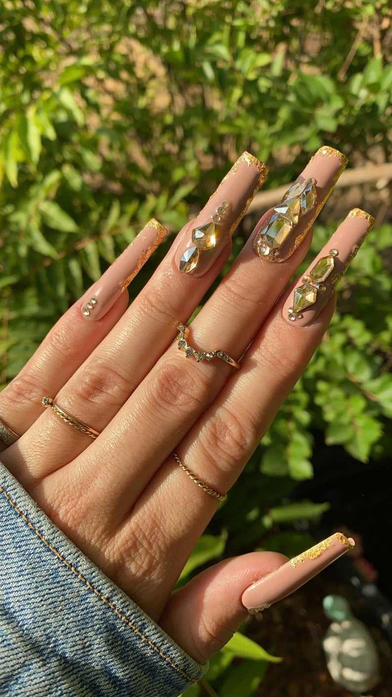 Nude nails with gold rhinestones