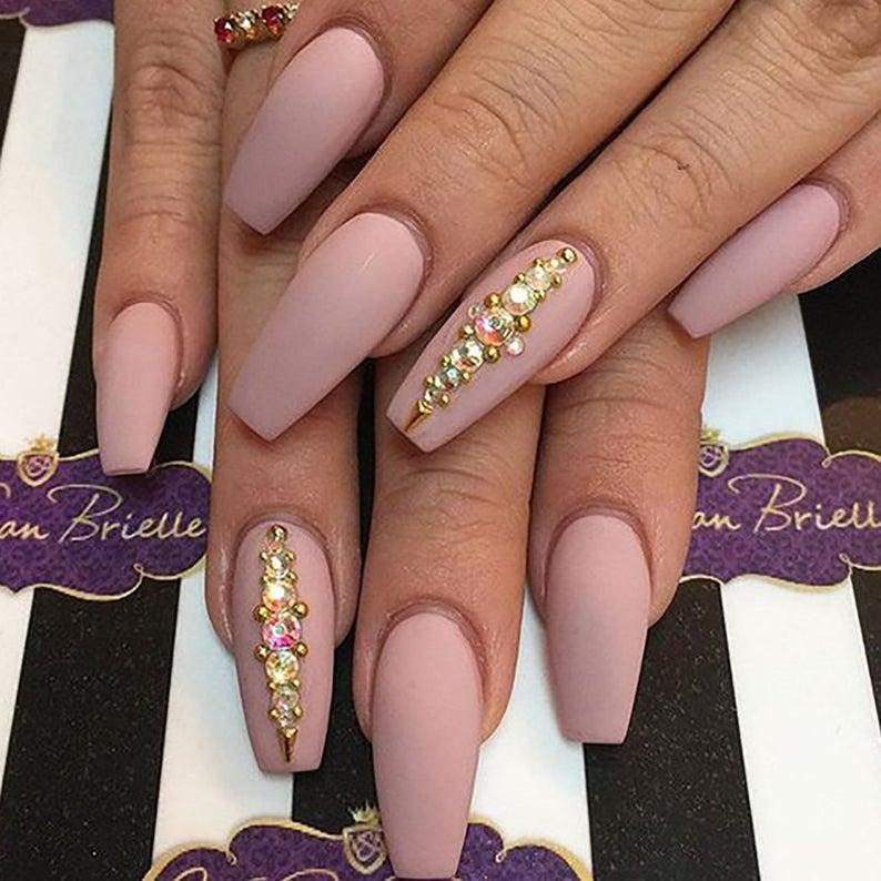 Mauve pink matte nails with rhinestones